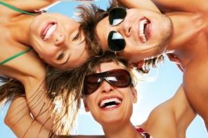 Three best friends having a laugh on the beach